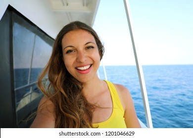 Selfie photo of young model woman on luxury travel cruise vacation in yellow dress enjoying the evening on Amalfi Coast getaway holidays. Happy traveler vacations in Italy. Copy space.