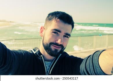 selfie portrait of young man outdoors