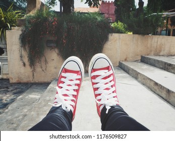 Selfie of red sneakers and flowers