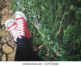 Selfie of red sneakers in the garden