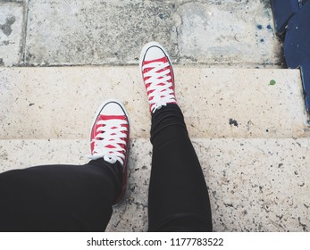 Selfie of red sneakers on staircase