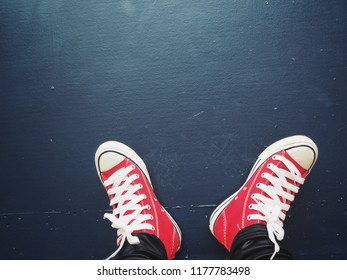 Selfie of red sneakers on vintage blue background