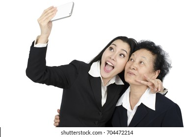 Selfie Senior woman with daughter over white background