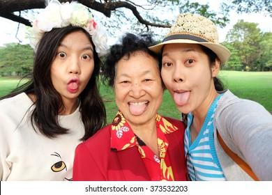 Selfie Senior woman with daughters
