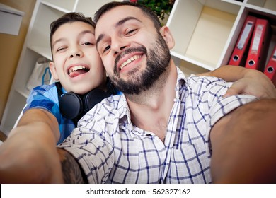 selfie son and dad, the concept of family values and selfie photo