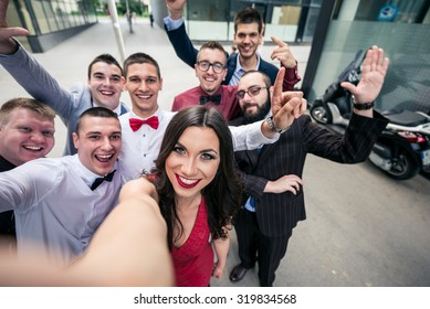 Selfie of the sucessful elegant business team. Selective focus, shallow depth of field.