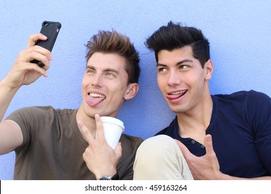 Selfie! teenagers taking pictures in the city