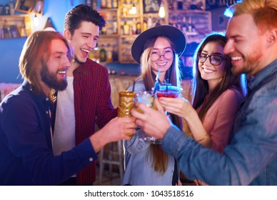 Selfie Time.Young Group of Friends Partying In A Nightclub And Toasting Drinks. Happy Young People With Cocktails At Pub. The People Have A Great Mood And They Smile A Lot.
