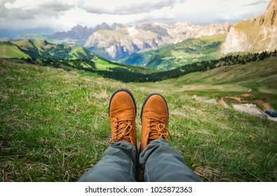Selfie trekking boots hiker while sitting on top mountain background, Dolomites, Italy concept adventure, summer vacation activity, freedom, inspiration