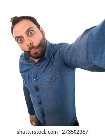 Selfie of a young man with wow expression on white background.