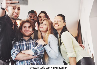 Selfie of young smiling people having fun together. Best friends forever.
