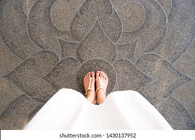Selfie Young Woman of Feet in Fashion Shoes on Concrete Floor. Beautiful Girl Standing is Foot & Slim Legs Seen from Above on Road Street. Flat Shoe (Sandal) on Cement Layoknok Background, Top View.
