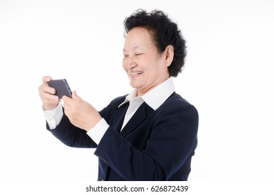 Selfie,Business Senior woman with texting on cellphone over white background
