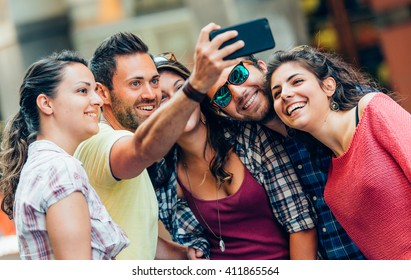 Selfie!teenagers taking pictures in the city