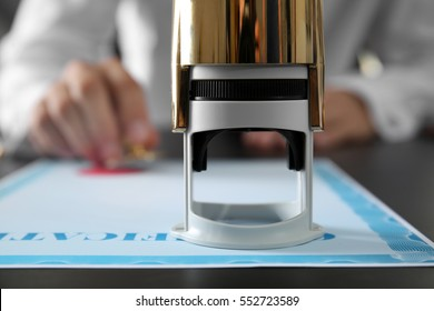 Self-ink stamp on notary public table