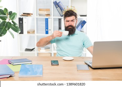 selfish secretary. selfish businessman in gold crown. selfish man drink coffee. Boss or secretary workplace. Bearded selfish man in business office. egoist. wishing to be big boss. reward and success.
