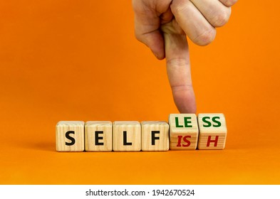 Selfish or selfless symbol. Businessman turns cubes and changes the word 'selfish' to 'selfless'. Beautiful orange background, copy space. Business, psuchological and selfish or selfless concept.