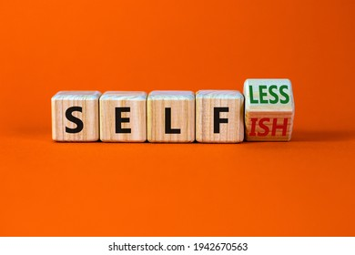 Selfish or selfless symbol. Turned cubes and changed the word 'selfish' to 'selfless'. Beautiful orange background, copy space. Business, psuchological and selfish or selfless concept.