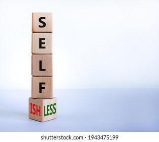 Selfish or selfless symbol. Turned cubes and changed the word 'selfish' to 'selfless'. Beautiful white background, copy space. Business, psuchological and selfish or selfless concept.