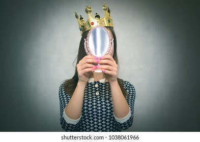 Selfish woman. Arrogant disgruntled girl with high self esteem. Egoist person woman with golden crown on her head. Dissatisfied winner.