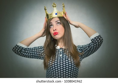Selfish woman. Arrogant girl with high self esteem. Egoist person woman with golden crown on her head. Winner.