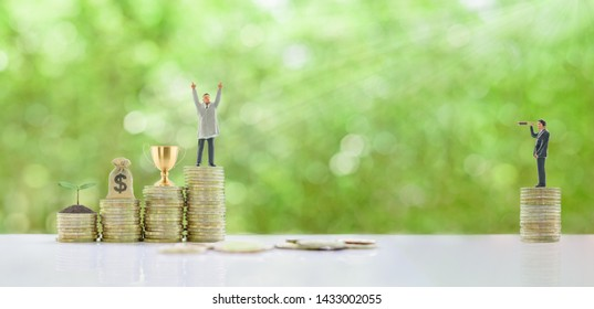 Self-made millionaire / become a billionaire from nothing, story of successful leader concept : Business tycoon raise hand to show dignity, trophy cup of winner, dollar bag, growing small tree on coin