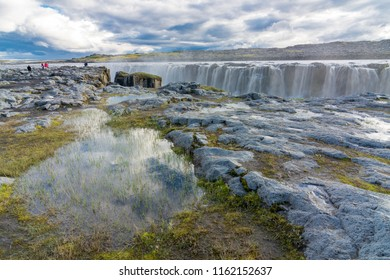 SELFOSS, ICELAND - JULY 25, 2018: People touring the beautiful Selfoss Waterfall and canyon in the Jokulsargljufur National Park in North Iceland