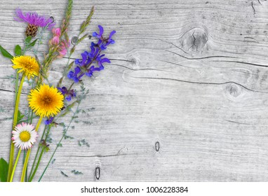 self-picked meadow flowers on wood