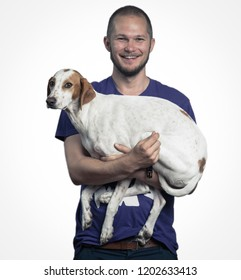 Self-portait holding a pointer dog in a studio