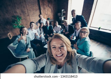 Self-portrait above high angle view of nice stylish cheerful glad positive director company staff showing thumbsup yes goal achievement recommend modern industrial loft interior work place open space