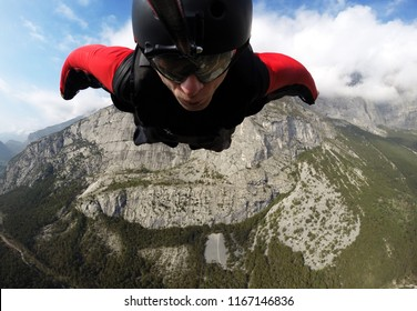 self-portrait of the base jumper in flight from the cliff, base jumping, wingsuit