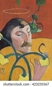 Self-Portrait, by Paul Gauguin, 1889, French Post-Impressionist painting, oil on wood panel. Gauguin's disembodied head and one hand floats with symbols of good and evil, and heaven and hell. He buil