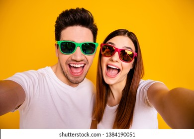 Self-portrait of his he her she two nice attractive lovely charming stylish trendy cheerful cheery glad people having fun isolated over vivid shine bright yellow background