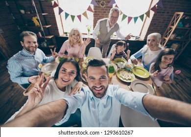 Self-portrait selfie of nice attractive lovely cheerful positive family small little brother sister event party joy showing v-sign symbol victory peace morning day in loft industrial interior