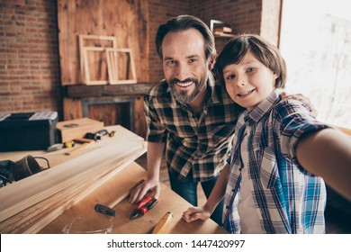 Self-portrait of two nice person cheerful cheery woodworkers handymen generation creating construction at school course class studio modern loft industrial brick interior indoors