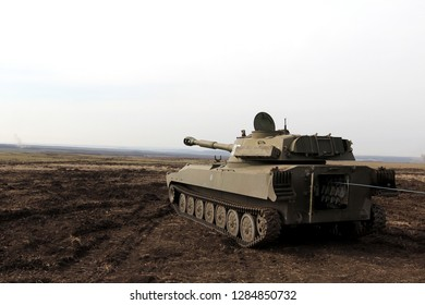 self-propelled artillery large caliber is in the field, rear view, Ukraine and Donbass conflict