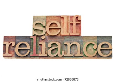 selfreliance - internet and search engine optimization (SEO) concept -  isolated text in vintage wood letterpress type, stained by color inks