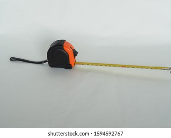 Self-retracting metal tape measure  A tape measure or measuring tape is a flexible ruler and used to measure distance.  It consists of a ribbon of cloth, plastic, fibre glass, or metal strip