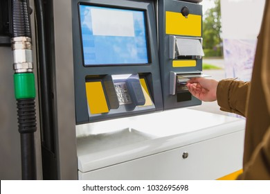 Self-service filling station. The man pays for fuel with a credit card