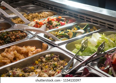 Self-service salad buffet in canteen with a huge variety of salads and vegetables