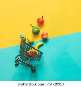Self-service supermarket full shopping trolley cart with fresh grocery products and fuit