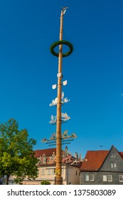 Seligenstadt, Germany - May 2010: View of the top part of the maypole (Maibaum) on the marketplace. From Germanic paganism and early medieval cultures, the tradition survived in some parts of Europe.