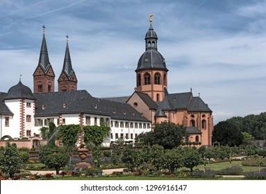 SELIGENSTADT, GERMANY-JULY 05, 2018: monastery seligenstadt (basilica of saint marcellinus and peter) and garden