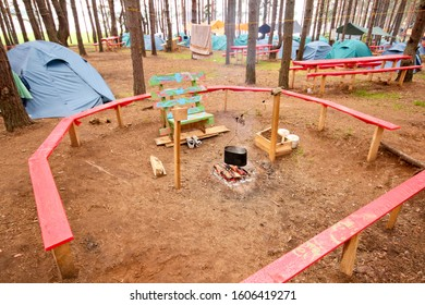 SELIGER / RUSSIA - JULY 15, 2012: Tent camp in the forest near the lake Seliger. Fireplace, cooking on fire.