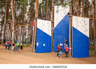 SELIGER / RUSSIA - JULY 15, 2012: Climbing wall in the forest. Climbers on the wall.