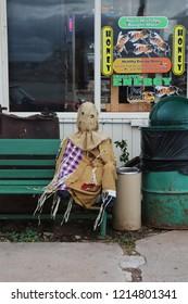 Seligman, Arizona / USA - October 12 2018:  A horror scarecrow mounted on a bench. Halloween Decor