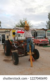 Seligman, Arizona / USA - October 12 2018:  Scarecrow hitched to the bumper of the tractor. Horror on the roads. Decor to Halloween.