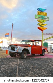 Seligman, Arizona / USA - October 12 2018:  Red old pickup under the sign of the hotel and shops on Historic Route 66. USA, Arizona.