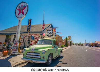 Seligman, AZ, USA - July 12, 2016: Antique Pickup Truck in front of a Texaco Gas Station on Route 66