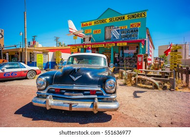 Seligman, AZ, USA - July 12, 2016: 1953 Chrysler New Yorker Police Car in front of Historic Seligman Sundries Cafe on Route 66 Arizona